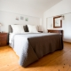 The master bedroom with a kingsize boxspring bed